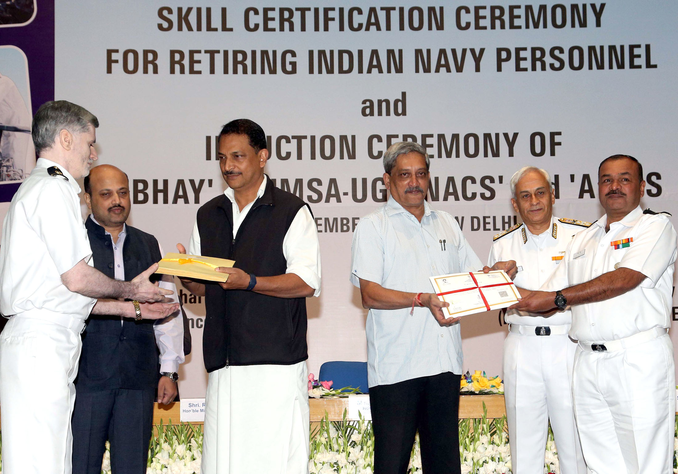 The Union Minister for Defence, Shri Manohar Parrikar and the Minister of State for Skill Development & Entrepreneurship (Independent Charge) and Parliamentary Affairs, Shri Rajiv Pratap Rudy jointly distributing the Skill Certificates and Placement Letters to retiring Navy Personnel, on the occasion of handing over of four indigenous Naval Systems, developed by DRDO to the Indian Navy and distribution of Skill Certificates and Placement letters to retiring Navy personnel, in New Delhi on November 18, 2016. 	The Chief of Naval Staff, Admiral Sunil Lanba is also seen.